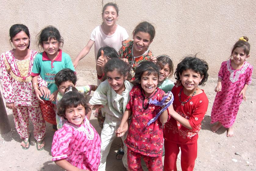 Photograph of Iraqi girls with huge smiles. Photograph by an American soldier of C Co, 1/252 Army Reserve Battalion.